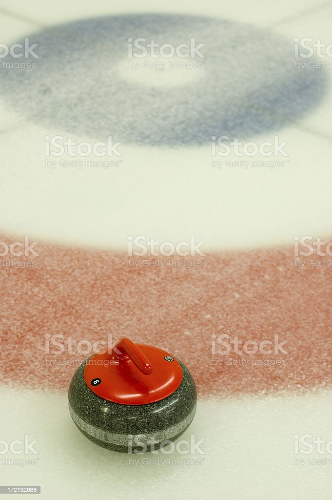 Curling Rock on the Ice stock photo