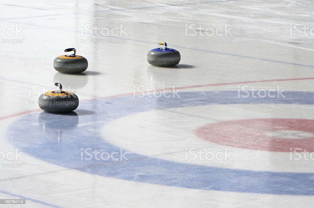 Curling rocks on an outdoor rink stock photo