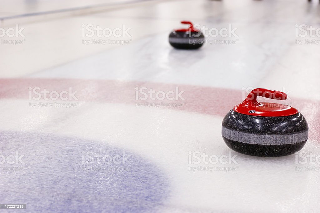 Curling Rocks on the Ice stock photo