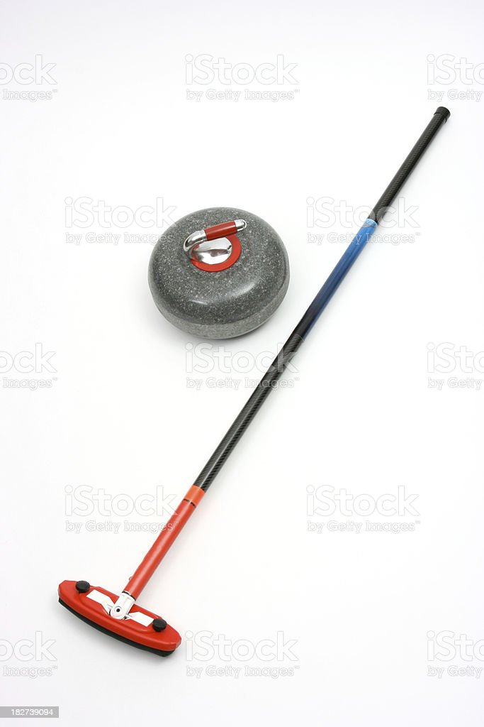 Curling stone and rock stock photo