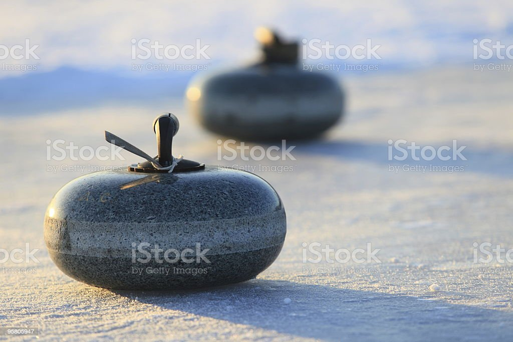 Curling Stones on Ice royalty-free stock photo