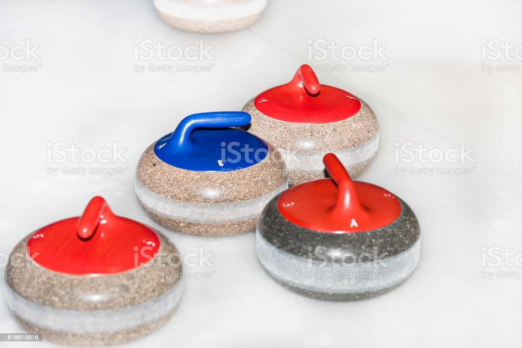 Curling stones on the ice stock photo