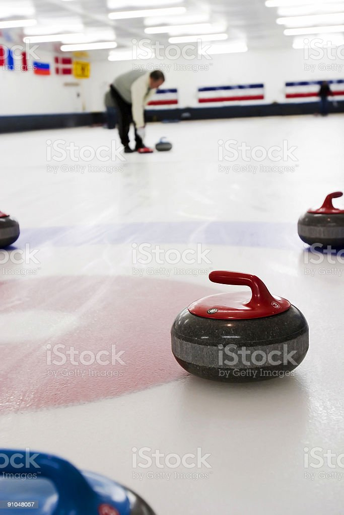 Curling Sweeper stock photo