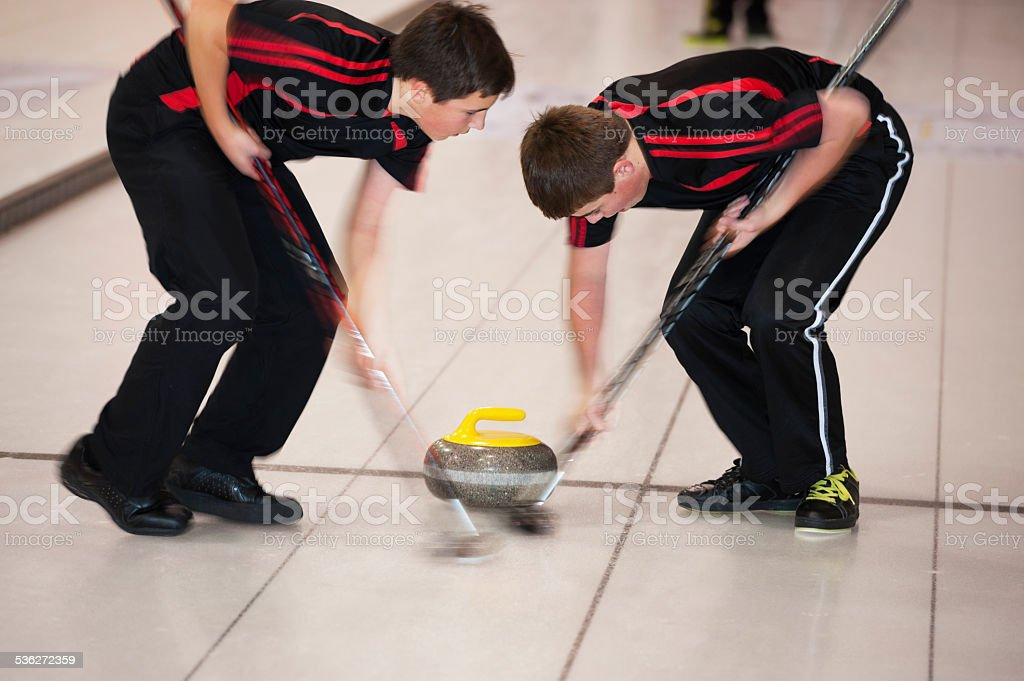 Curling sweeping stock photo