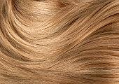 istock Curly blond hair 1286566072