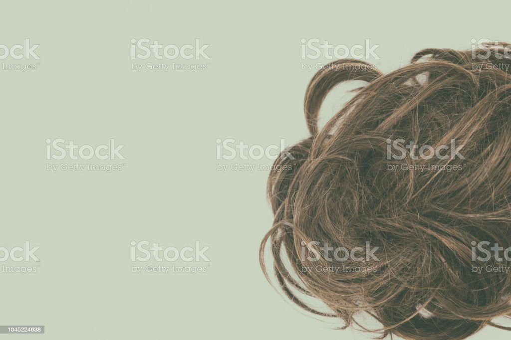 Brunette hair isolated on white background with vintage effect.