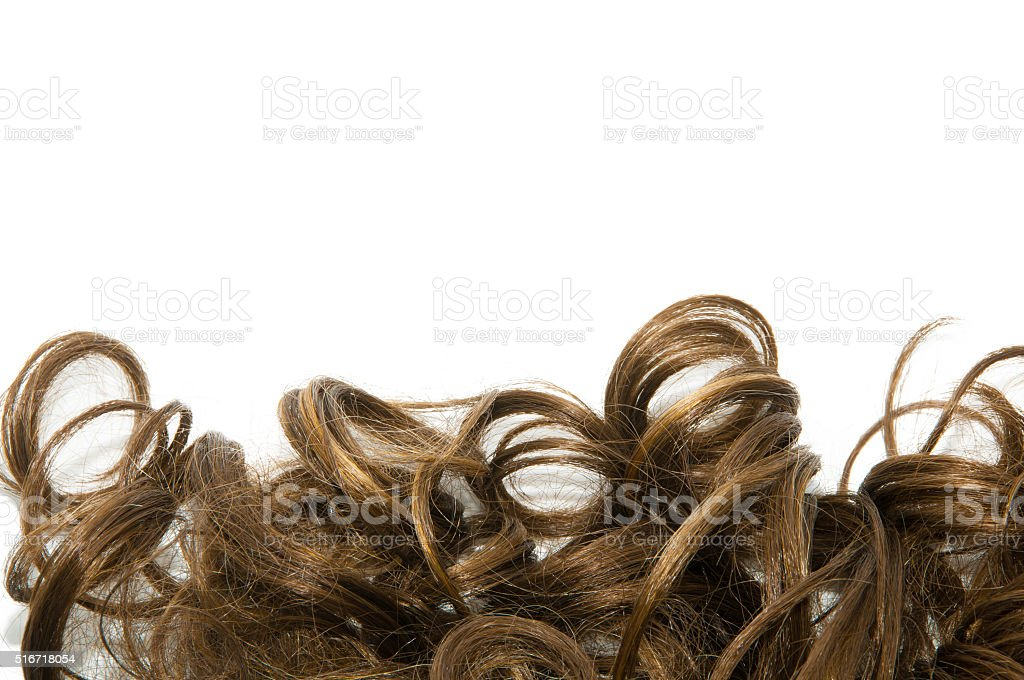 Curly brown hair over white background stock photo