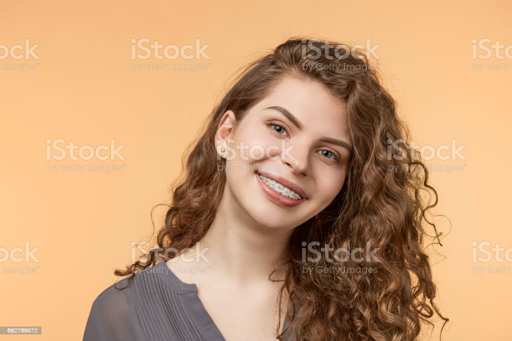 curly hair woman with brackets stock photo