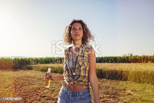 Beautiful curly haired girl standing and posing for the camera while on vacation