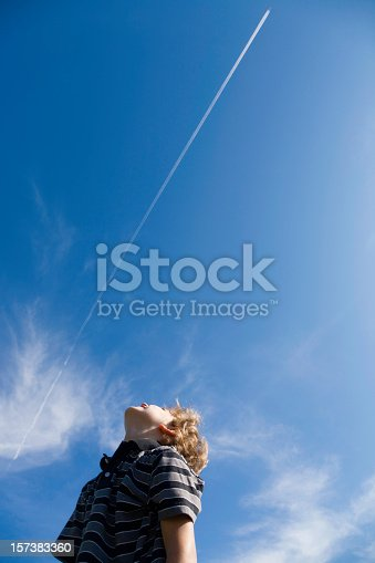 Boy looking at jet exhaust