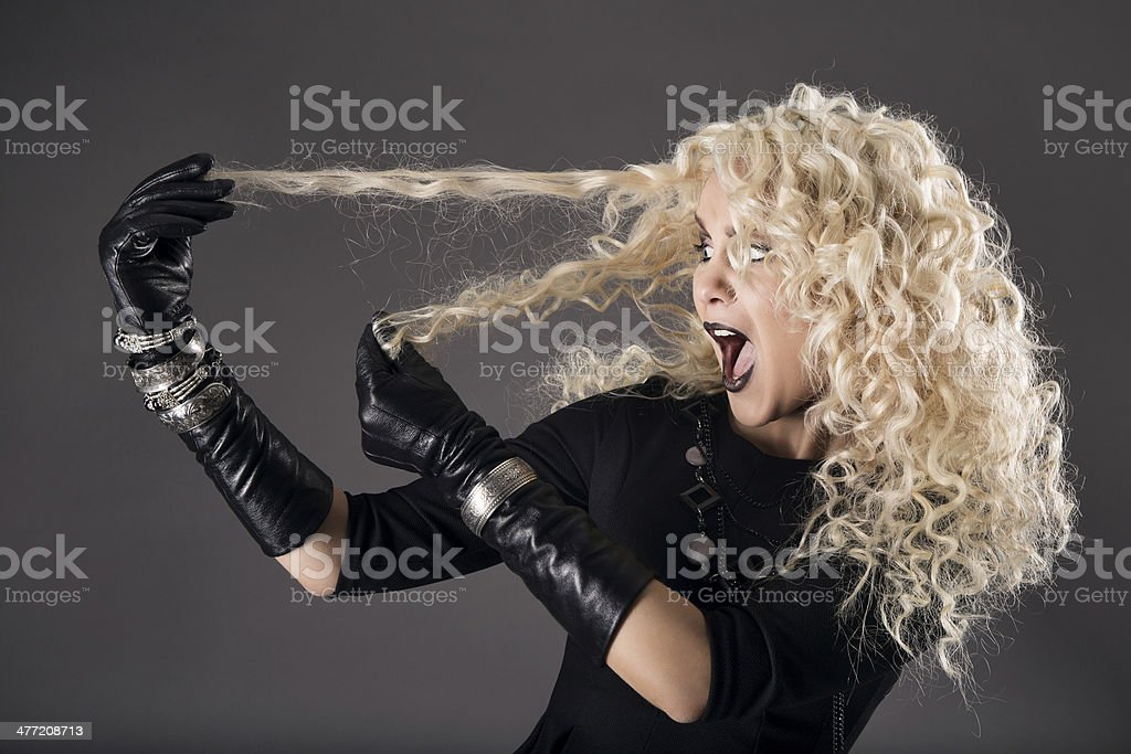 curly hairstyle blonde in black, woman hairs loss, coloring problem stock photo