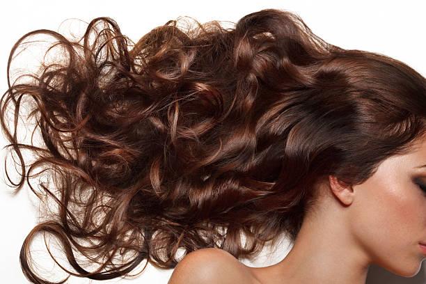 curly long hair. high quality image. - lang haar stockfoto's en -beelden