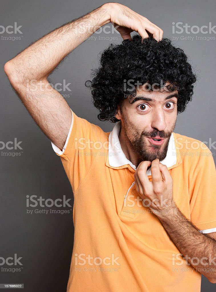 Curly man and his imitation of Monkey Face stock photo