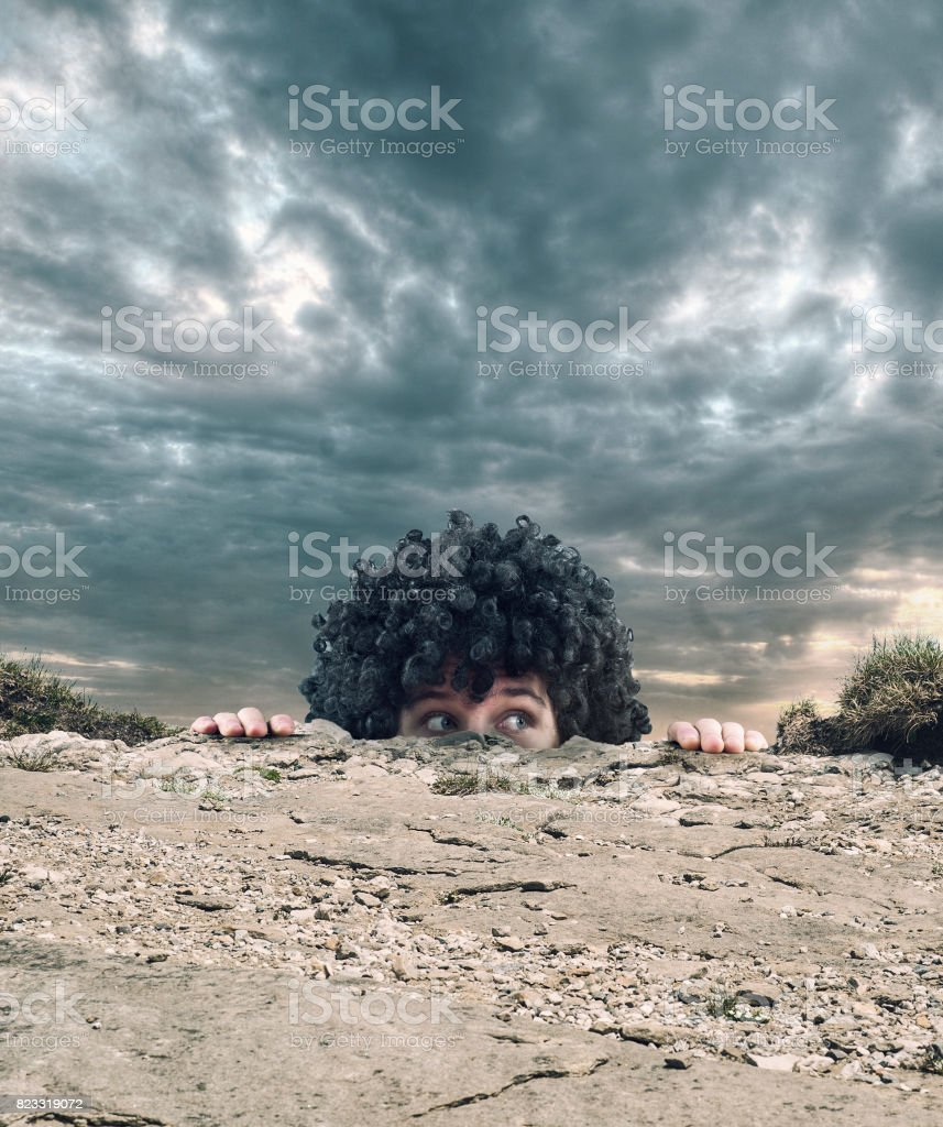 Curly man reach the top mountain stock photo
