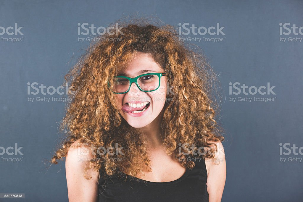 Curly Young Woman Portrait on Gray Background stock photo