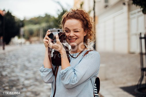 Girl holding a camera and smiling