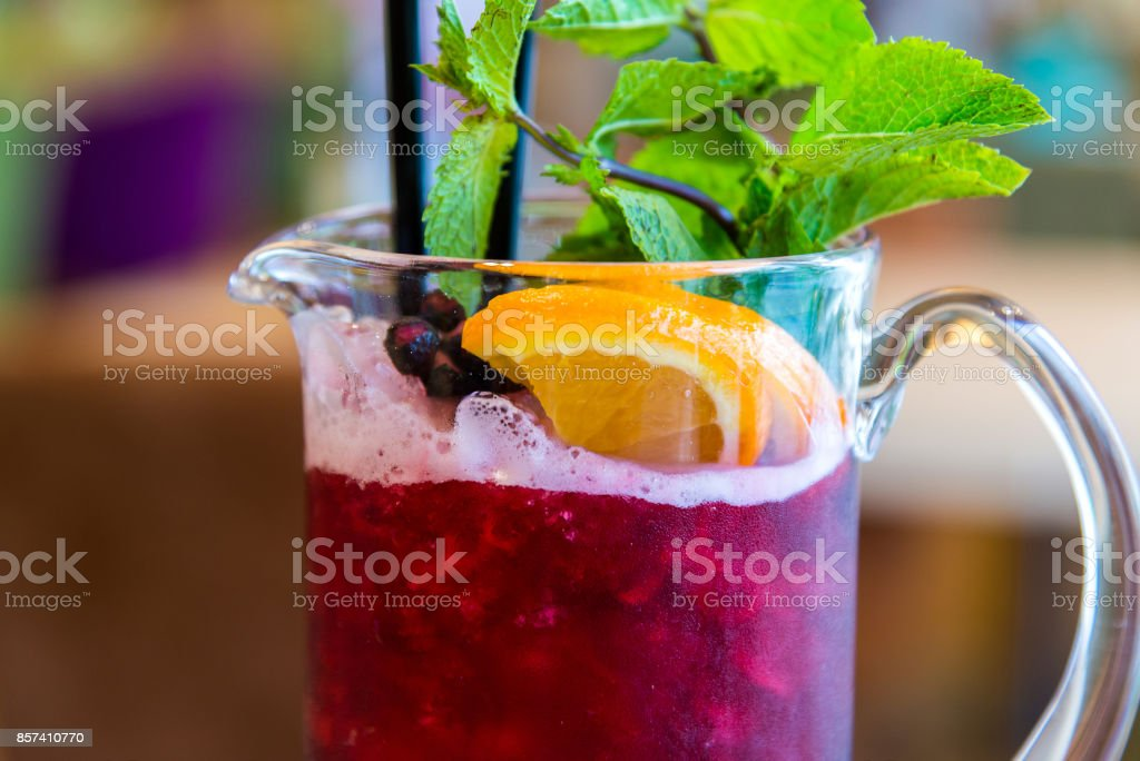 Currant ice lemonade on table in cafe stock photo