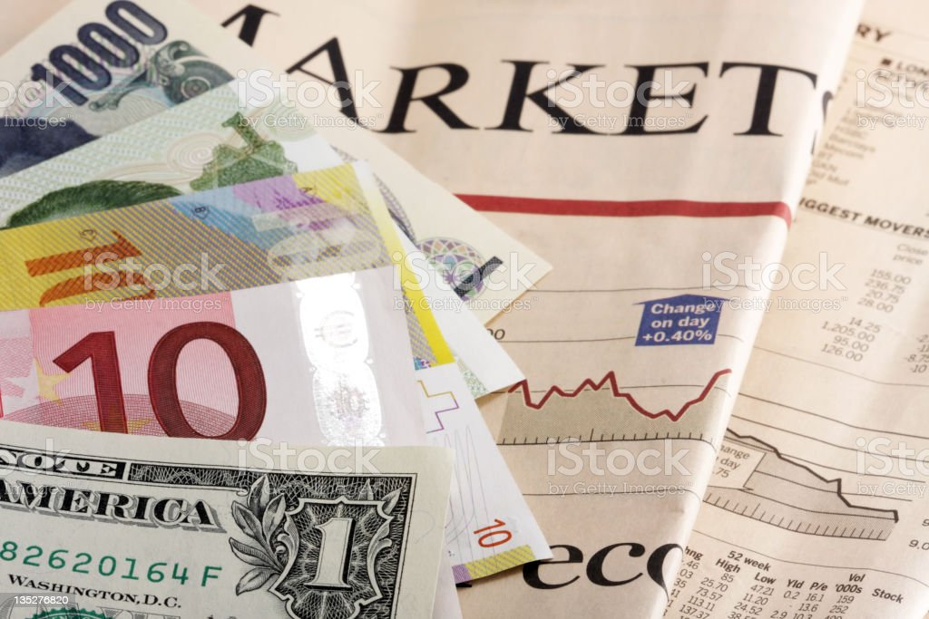 Currencies on a newspaper stock photo