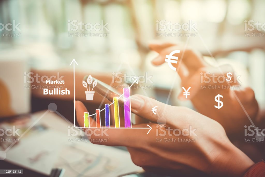 Currencies sign icon and market stock graph screen of smartphone. stock photo