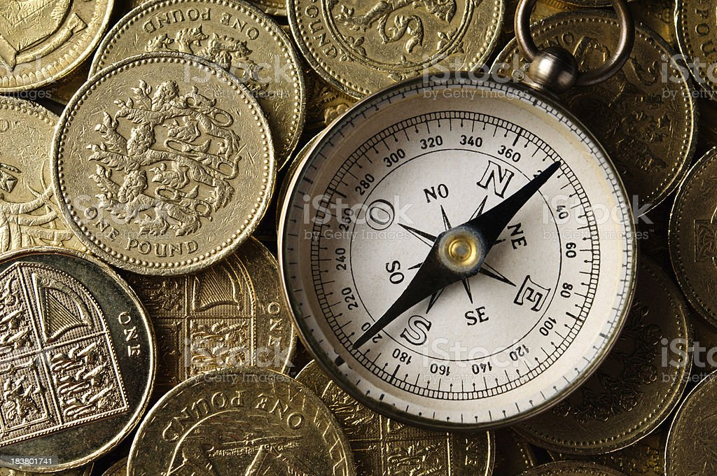 UK Currency and compass royalty-free stock photo