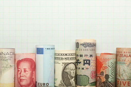 Different currencies forming a graph against grid background