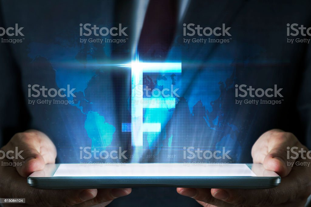 Currency concept on tablet with hologram stock photo