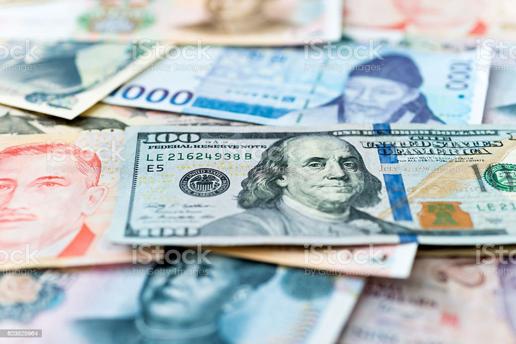 Currency from different countries of the world Money of the world, from US, China, Japan, South Korea and Singapore. Abundance Stock Photo