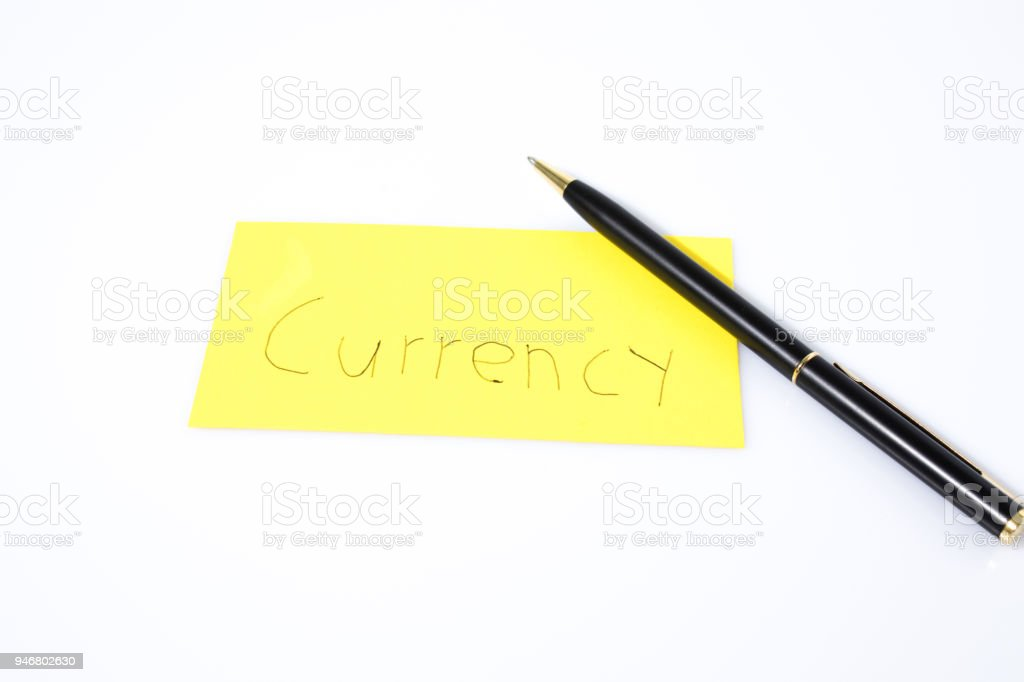 Currency handwrite with a pen on a yellow paper composition stock photo