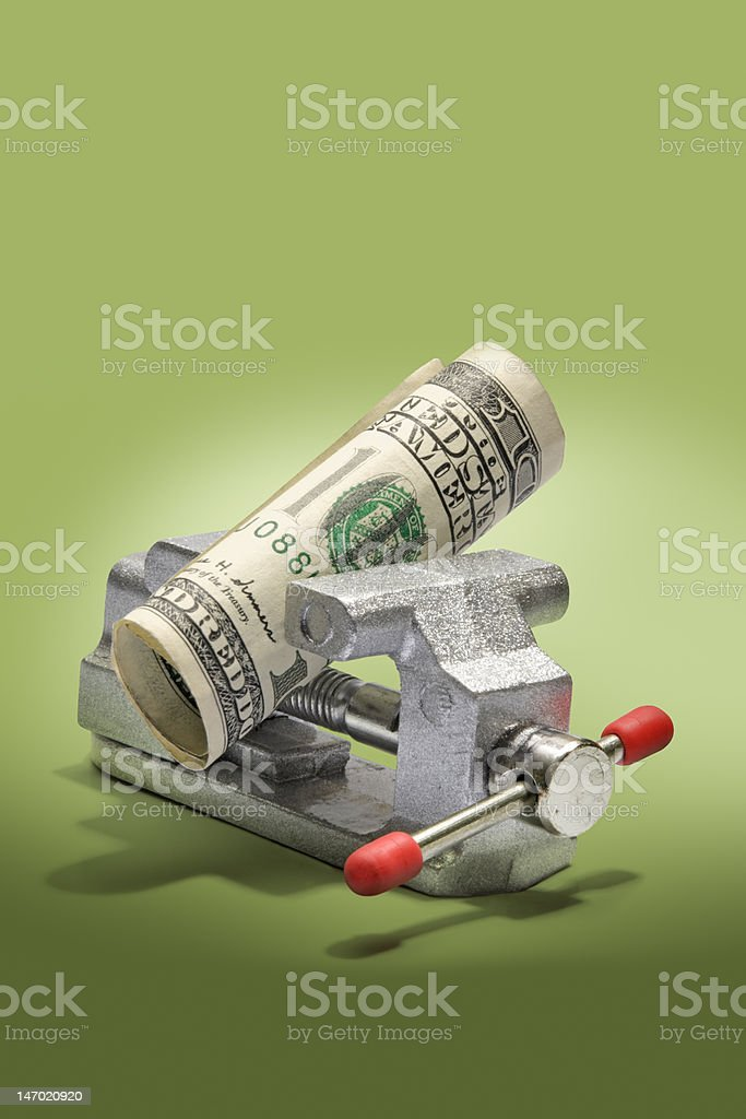 U.S. Currency in Miniature Vise stock photo
