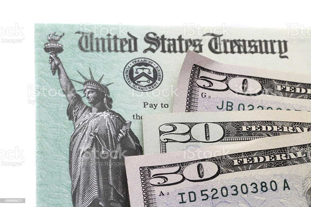 US currency on IRS tax refund check royalty-free stock photo
