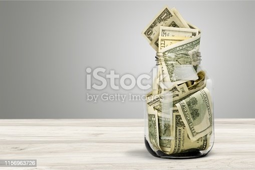 Glass jar for money on background