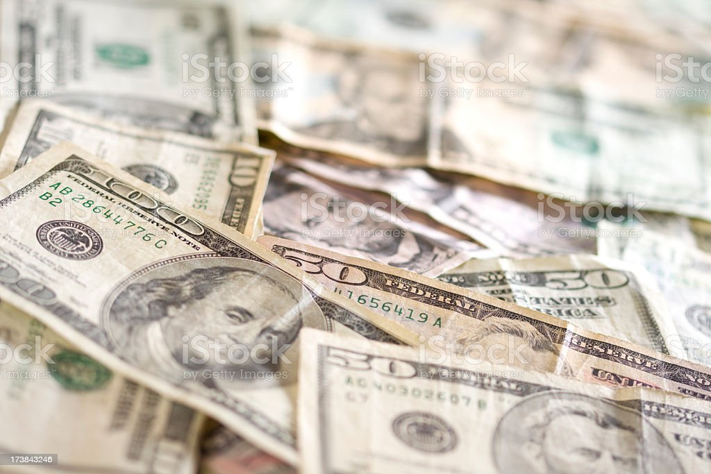 US Currency spread out on a table royalty-free stock photo