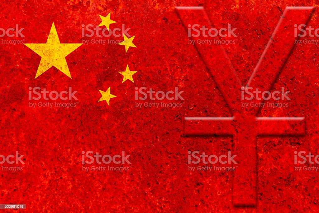 currency symbol (yuan) on the rustic chinese flag stock photo