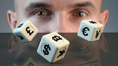 Currency trader uses dice to find out what to buy