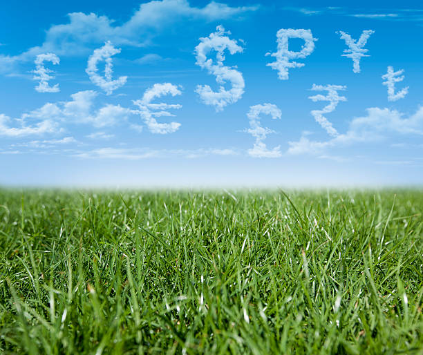 Currency units shaped clouds in blue sky stock photo