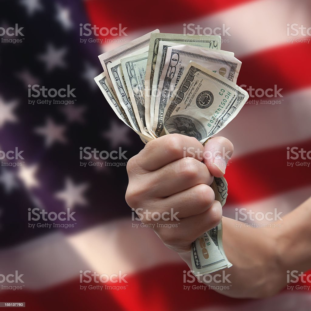 US Currency with American Flag royalty-free stock photo