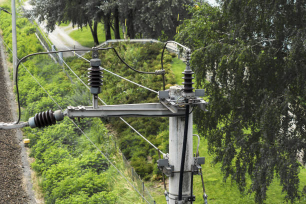 Current collector and insulator for the overhead contact line of an electric railway line, connected to a lightning conductor stock photo