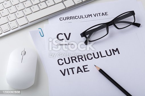 CV, curriculum vitae with computer keyboard and mouse, job interview