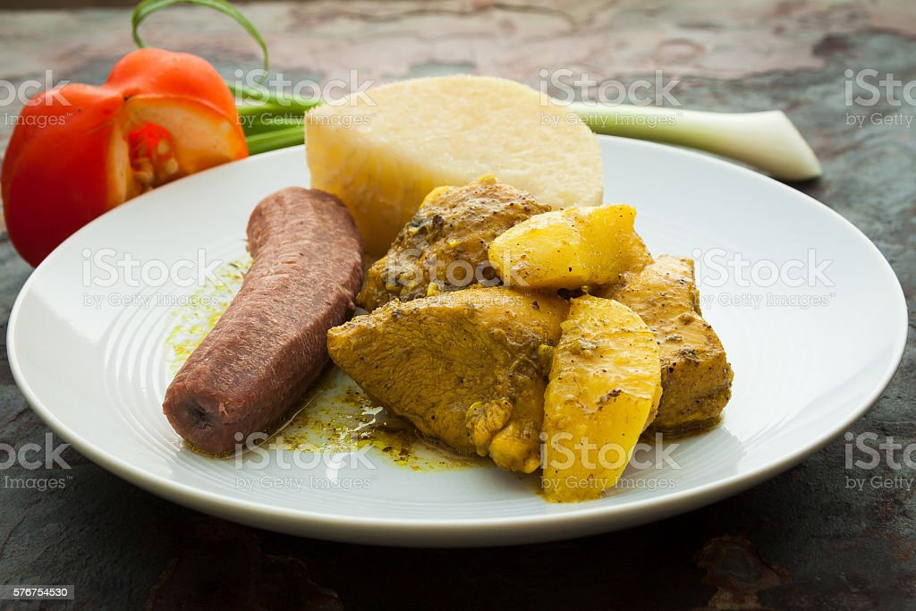 Curried Chicken Served With Boiled Bananas and Yams stock photo