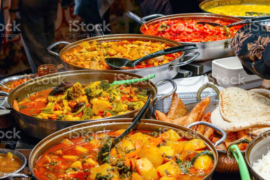 Curries on display at Camden Market in London stock photo