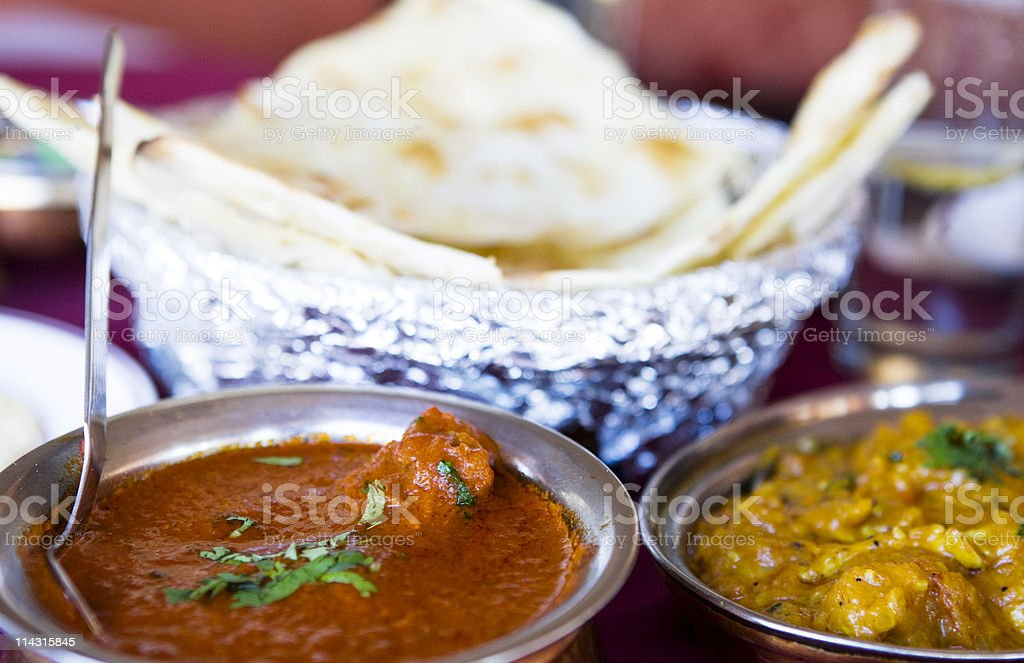 Curries with naan bread stock photo