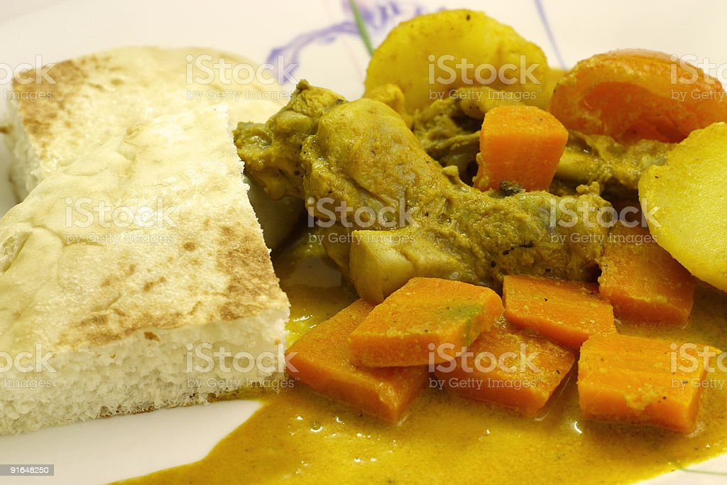 Curry Chicken with bread - close up stock photo