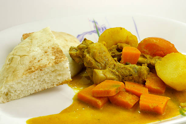 Curry chicken with bread stock photo
