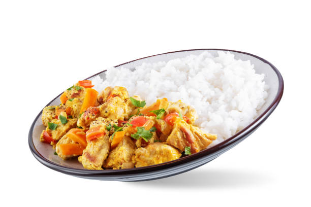 Curry chicken with rice in a plate on a white isolated background stock photo