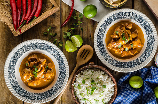 Curry chicken with rice Curry chicken with basmati rice, delicious and spicy food, fresh herbs, very simple to make balti dish stock pictures, royalty-free photos & images