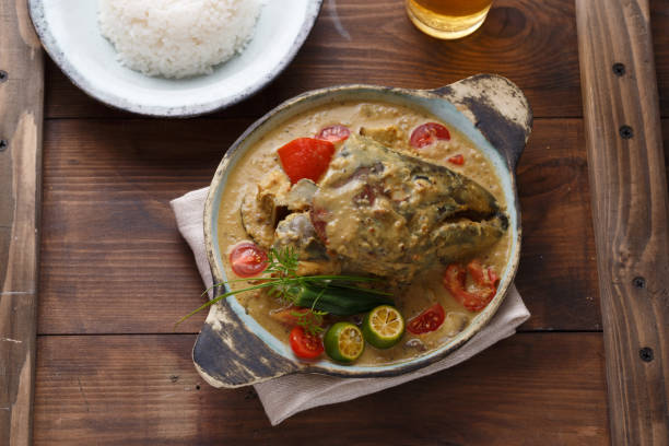 Curry fish head, Traditional singaporean cuisine stock photo