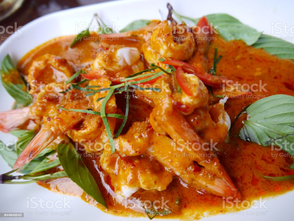 Curry fried shrimp or prawn with coconut milk stock photo