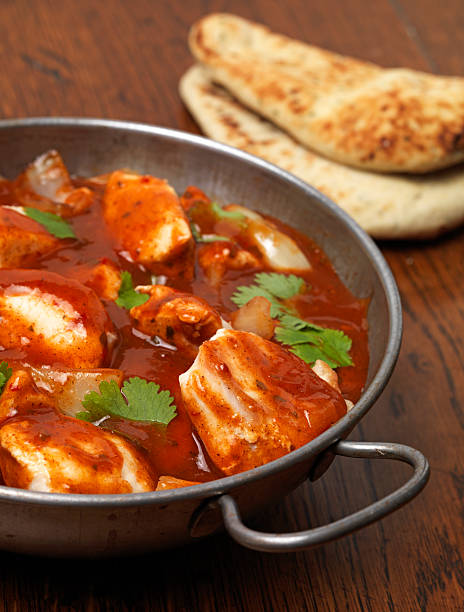curry night chicken curry with nan bread balti dish stock pictures, royalty-free photos & images