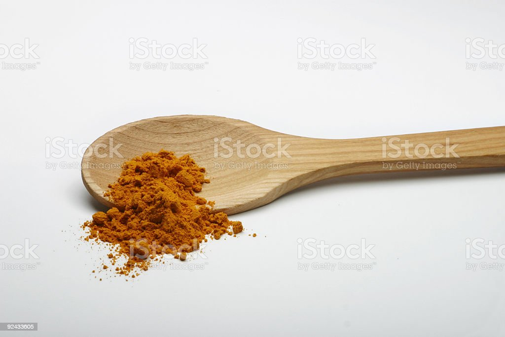 Curry on a wooden spoon royalty-free stock photo