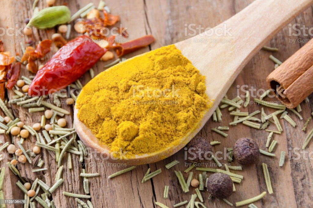Curry powder and various spices close up